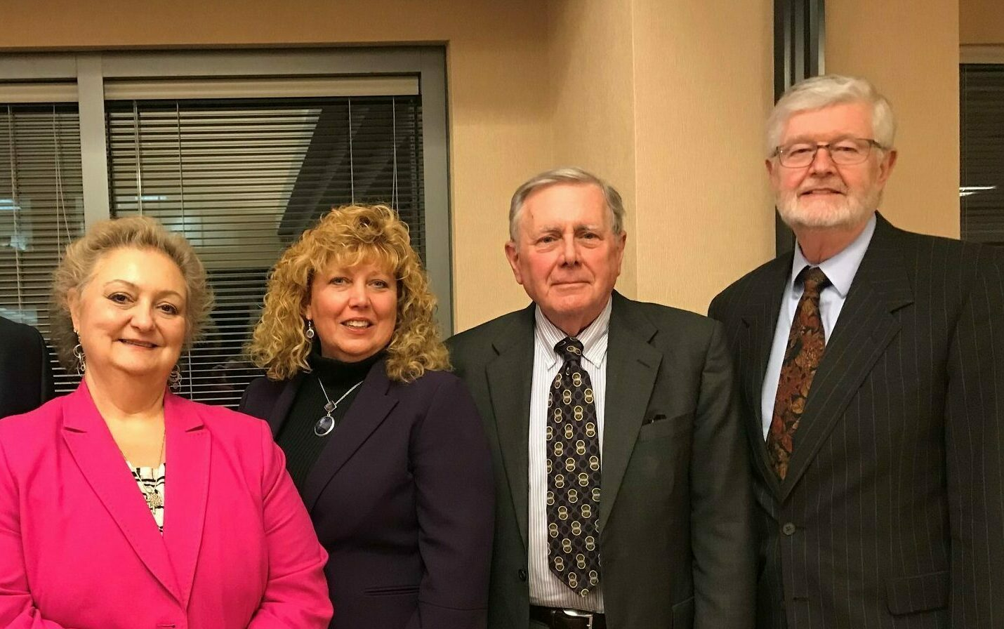 group photo of board members Carla Palumbo, Bruce Lawrence and David Schraver with Foundation Executive Deborah Auspelmyer