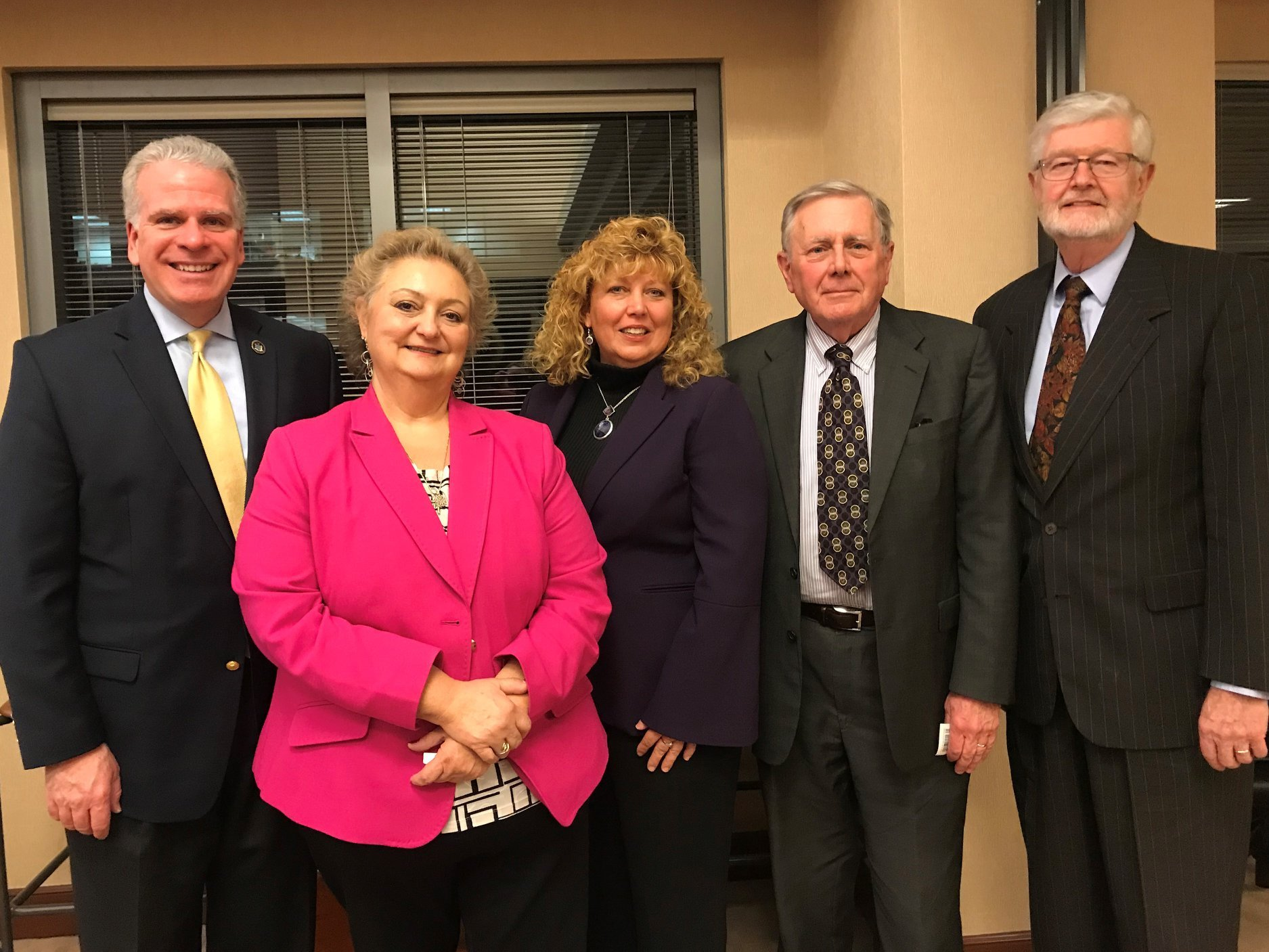 group photo of board members Carla Palumbo, Bruce Lawrence and David Schraver with Foundation Executive Deborah Auspelmyer and guest