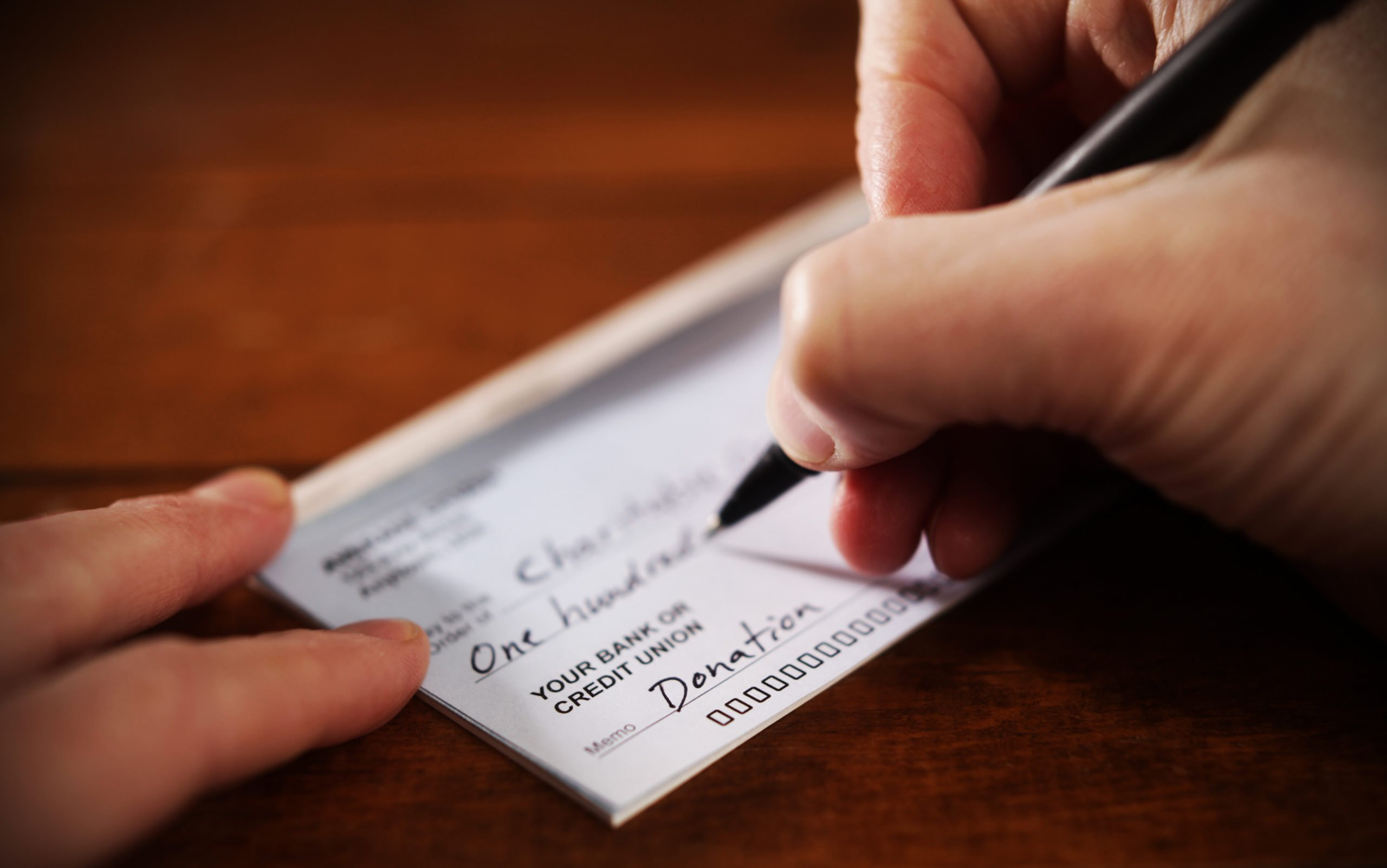 sample image of donation check being written