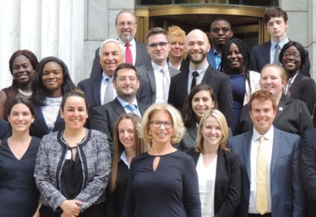 Group photo of the Honorable Janet DiFiore with Catalyst recipients on the steps of the courthouse