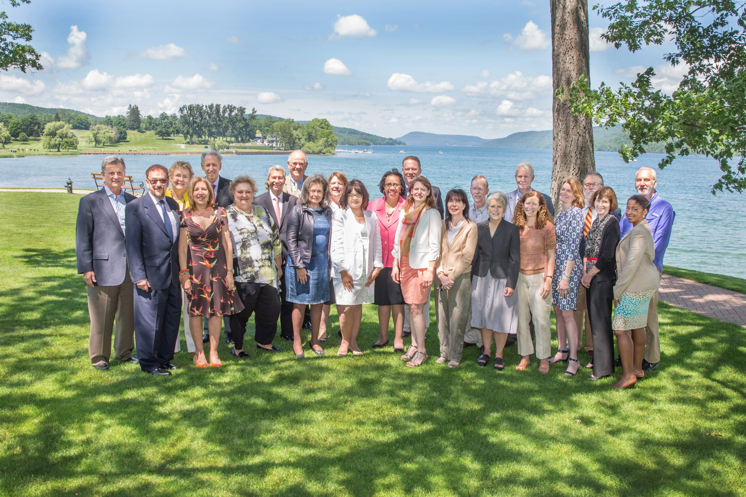 Group photo of Fellows standing in front of Otsego Lake, Cooperstown, New York