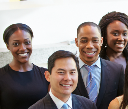 group photo of men and women in business attire