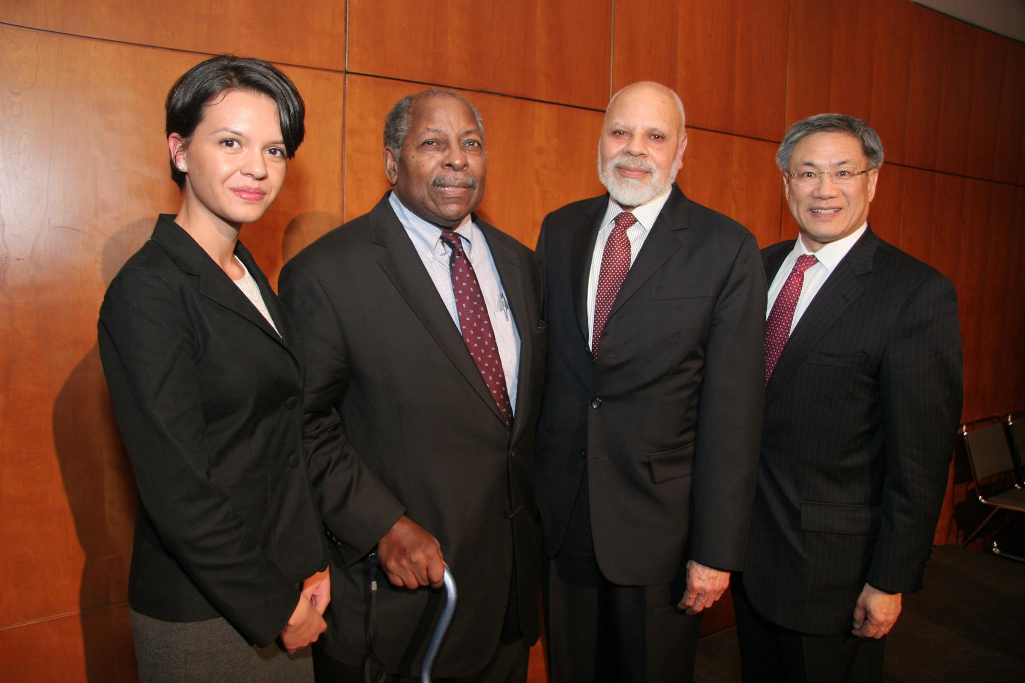 photo of 3 men and 1 woman, prior Corporate Counsel Award recipient
