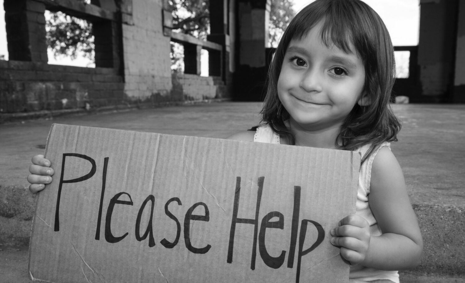 young girl holding Please Help sign